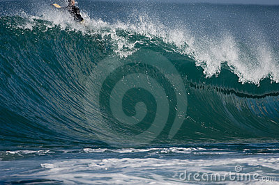 Surfer on huge wave