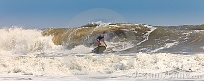Surfer on huge waves