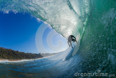 Surfer Inside Hollow Wave  Editorial Photo