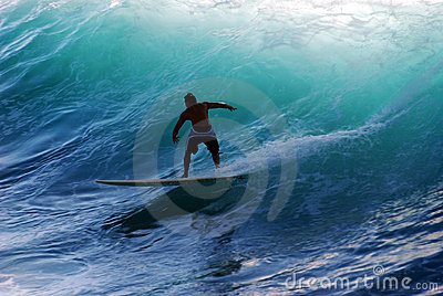 A surfer riding the wave