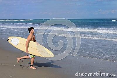 Surfer Running on Beach
