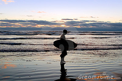 Surfer at Sunset on the Beach