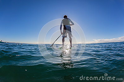 Surfer SUP Silhouetted Shadow Blue Editorial Stock Photo