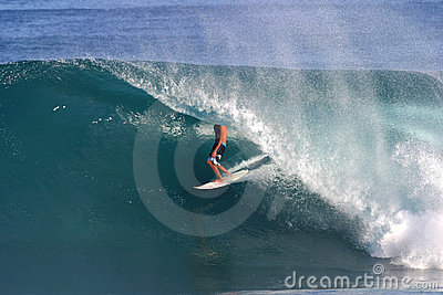 Surfer Surfing Backdoor Pipeline in Hawaii Stock Photo