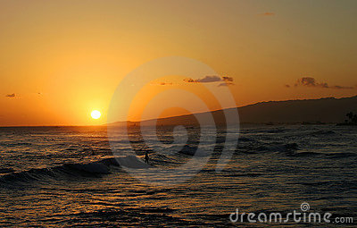 Surfer Surfing during a Hawaiian Sunset