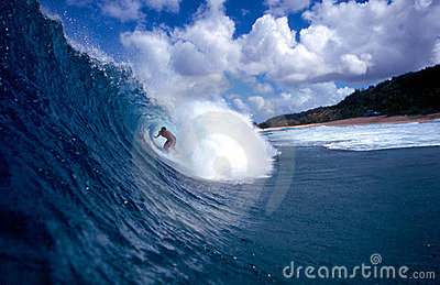 Surfer Surfing the Tube of a Blue Wave