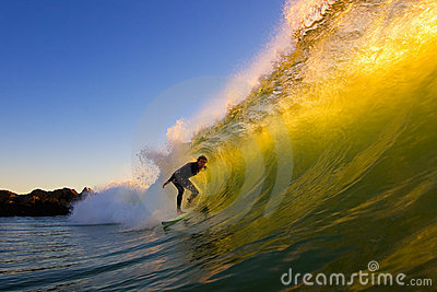 Surfer In The Tube at Sunset