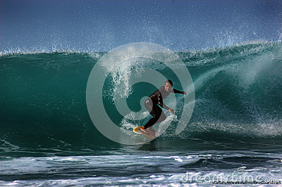 Surfer on a wave Editorial Stock Image