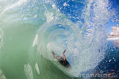 Surfer Crash Inside Hollow Wave Editorial Photo