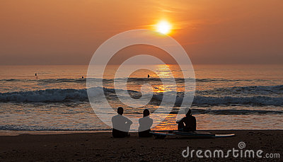 Surfers Admiring the Sunset
