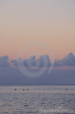 Surfers waiting at sunrise