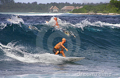 Surfing on Maldives Editorial Image