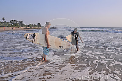 Surfing man Editorial Stock Image