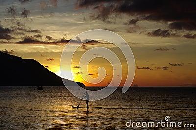 Surfing at sundown, Beau Vallon, Seychelles