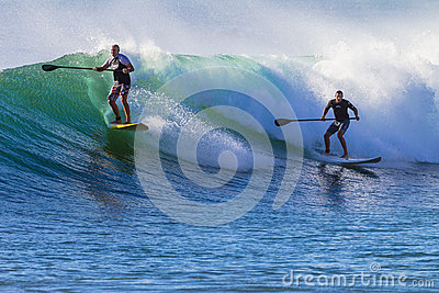 Surfers SUP Ridng Wave Editorial Stock Photo