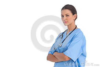 Surgeon with arms crossed