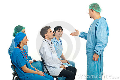 Surgeon man talking with doctors at seminar