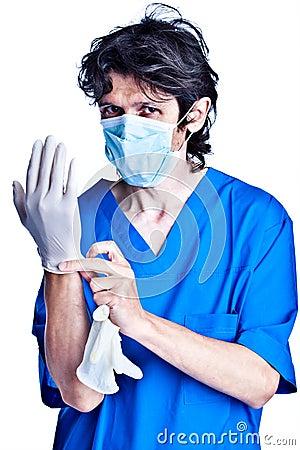 Surgeon struggle into gloves on hands