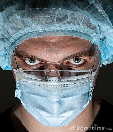 Surgeon in surgical mask