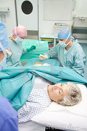 Surgical team performing operation