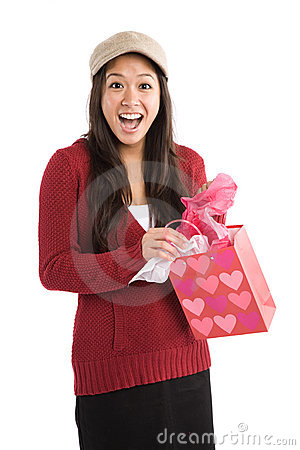 Surprised asian girl receiving valentine gift