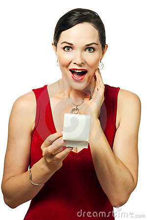 Surprised beautiful woman holding jewelery box