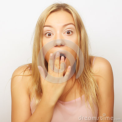 Free Surprised Blond Girl Holding Her Head In Amazement And Open-mout Stock Photo - 61175250