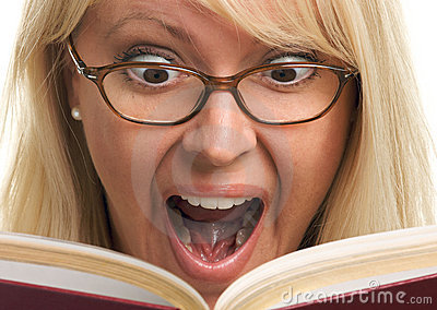 Surprised Blonde Reads a Book