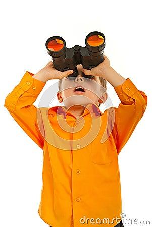 Surprised boy with binocular
