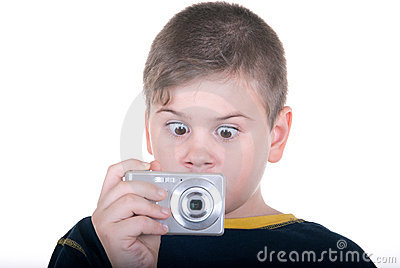 Surprised boy with  camera