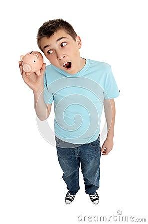 Surprised boy shaking money box