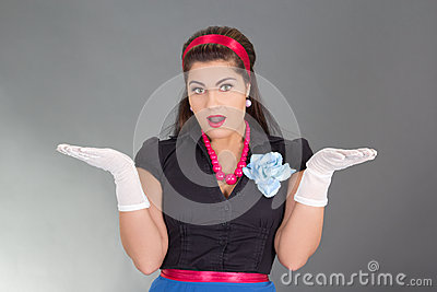 Amazed brunette woman in retro clothes