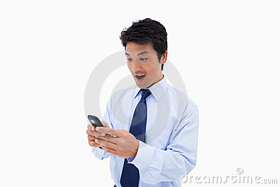 Surprised business man reading a text message