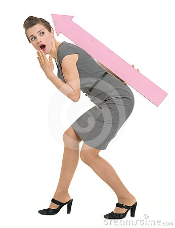 Surprised business woman carries on back big arrow