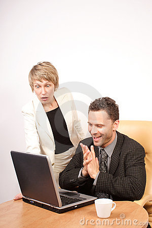 Surprised business woman and joyful business man