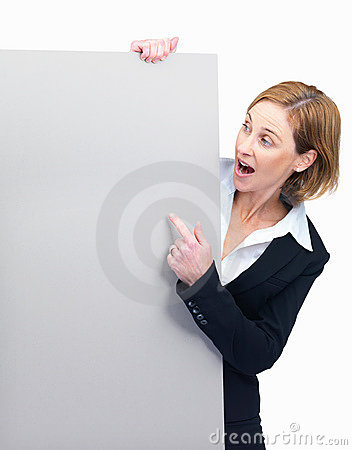 Surprised - Business woman looking at blank board