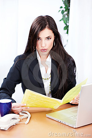 Surprised business woman reading files
