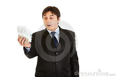 Surprised businessman holding money in his hand