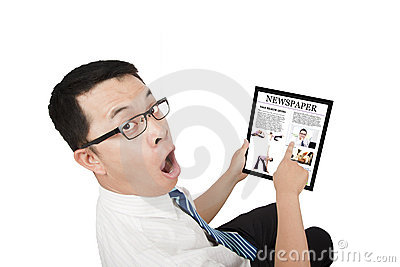 Surprised Businessman using a touch pad pc
