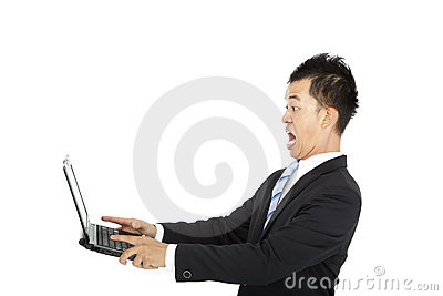 Surprised businessman watching computer