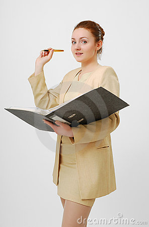 Surprised businesswoman with open folder