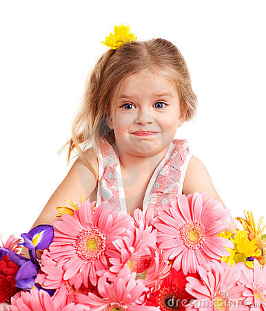 Surprised child holding flowers.