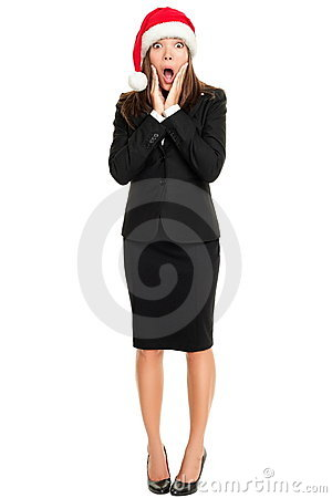 Surprised Christmas business woman isolated