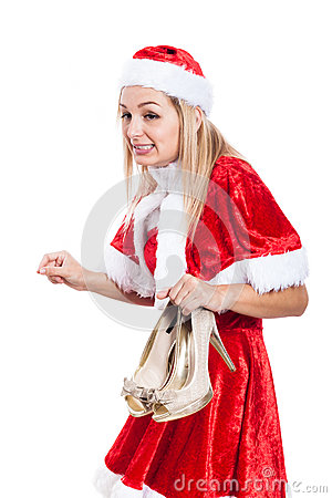 Surprised Christmas woman with shoes