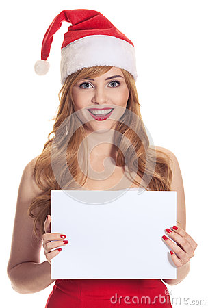 Surprised christmas woman wearing a santa hat