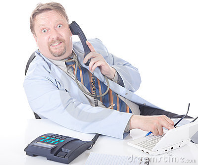 Surprised doctor calling at desk
