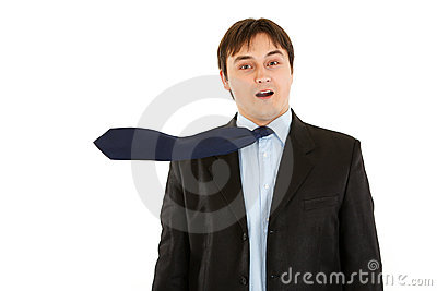 Surprised elegant businessman with blowing necktie