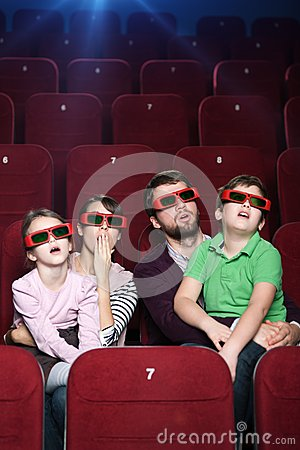 Surprised family in 3D movie theatre