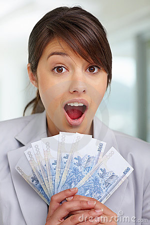 Surprised - Female with fan of currency notes