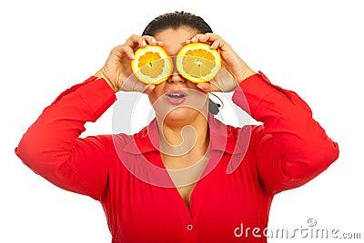 Surprised female holding orange